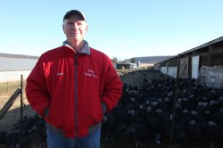 Mr. Koch stands proudly before his flock of turkeys.