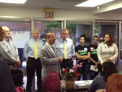 Climate scientist Michael Mann speaks alongside Terry McAuliffe at a campaign event in Virginia.