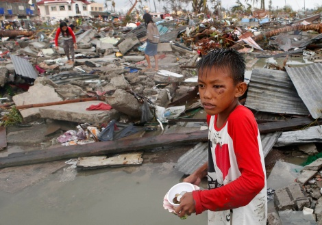 boy at scene of devastation caused by Typhoon Haiyan