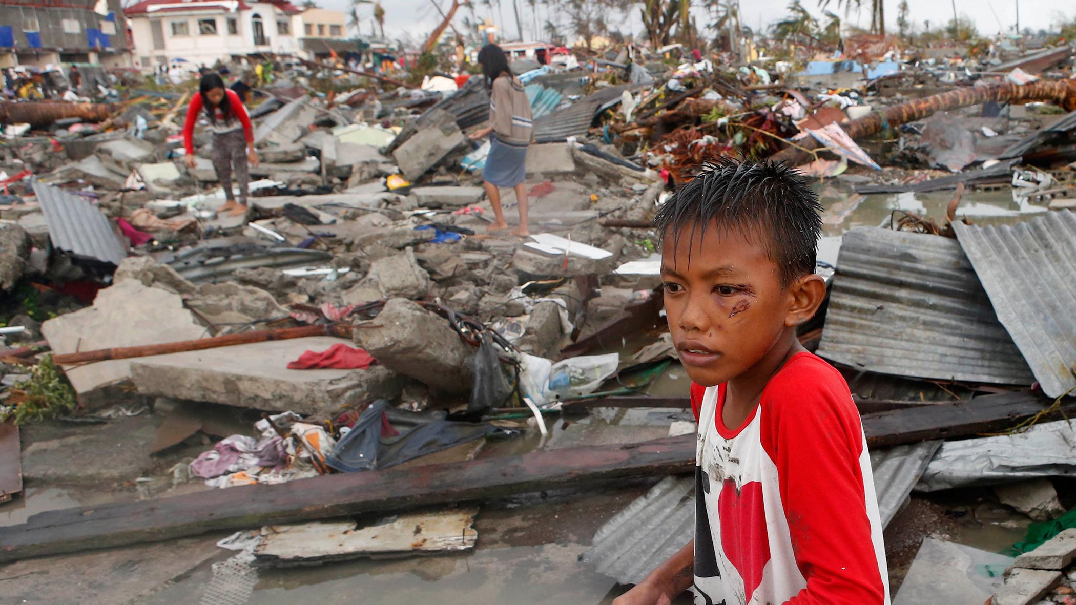 boy at scene of devastation from Typhoon Haiyan