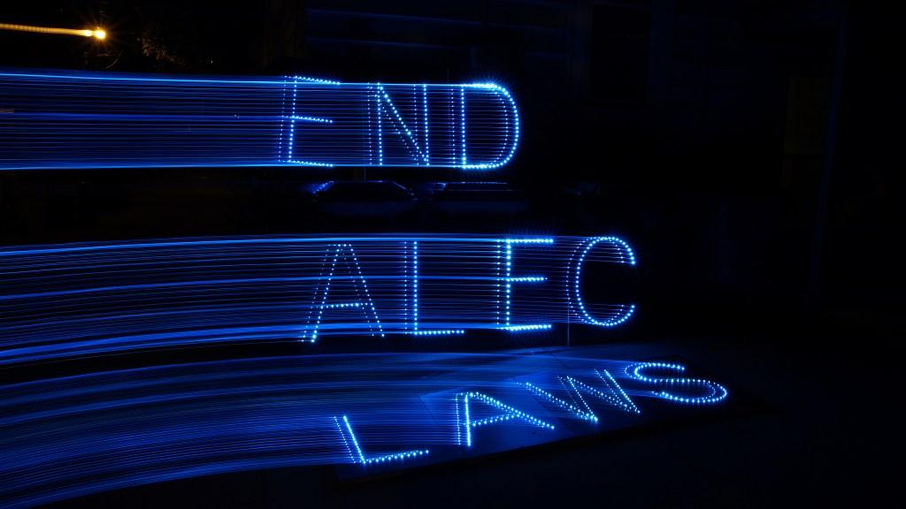 """end ALEC laws"" light display"
