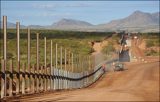 The border fence under construction in Arizona.