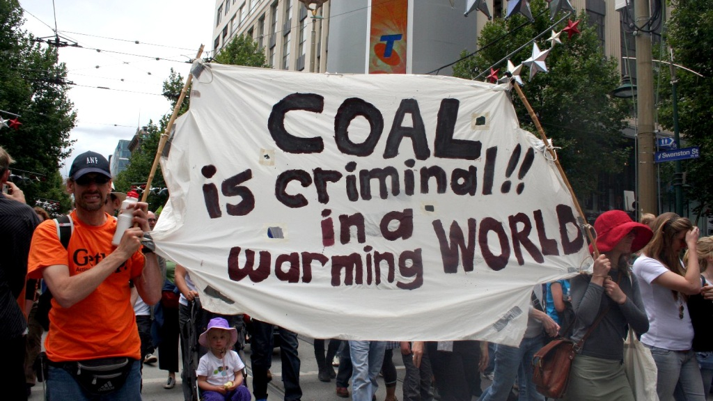 "protest sign: ""Coal is criminal in a warming world."""