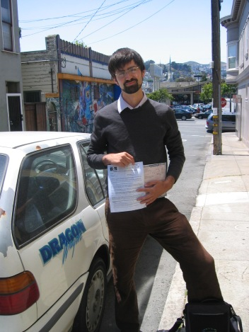 I posed for a picture with the title and final failed smog check before giving up the Dragon Wagon