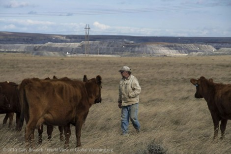 Rancher L.J. Turner looks after some of his red angus cattle on a pasture he leases from the federal Thunder Basin National Grassland. The success of his herd depends on this rich prairie. But underneath lies a thick seam of coal -- and the giant North Antelope Rochelle Mine in the background is gobbling up the prairie to get to it.