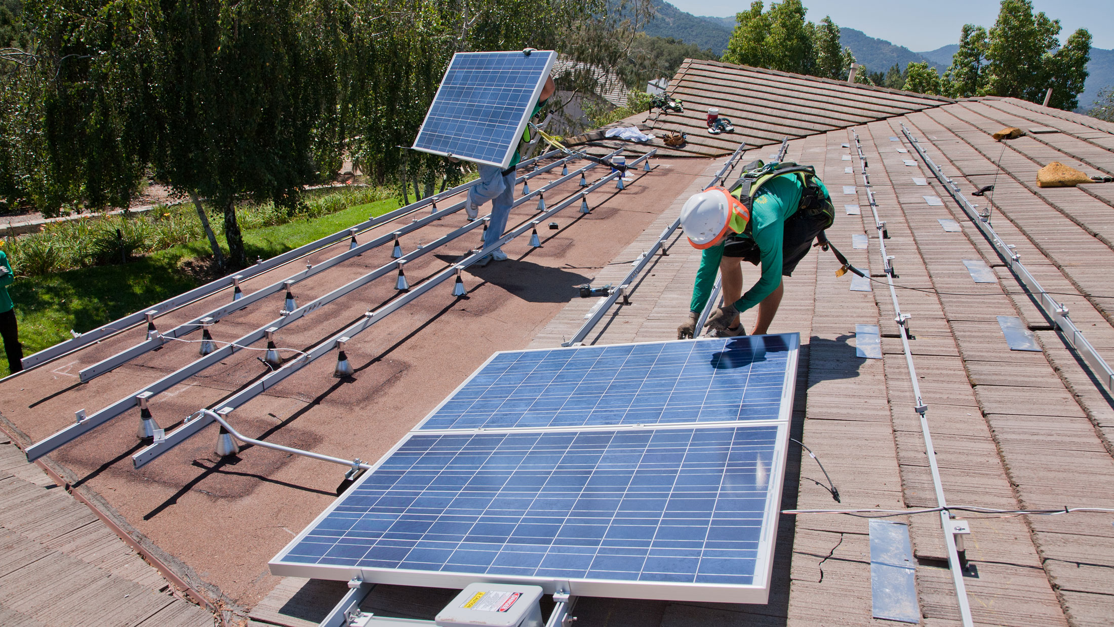 solar panels going up on a roof