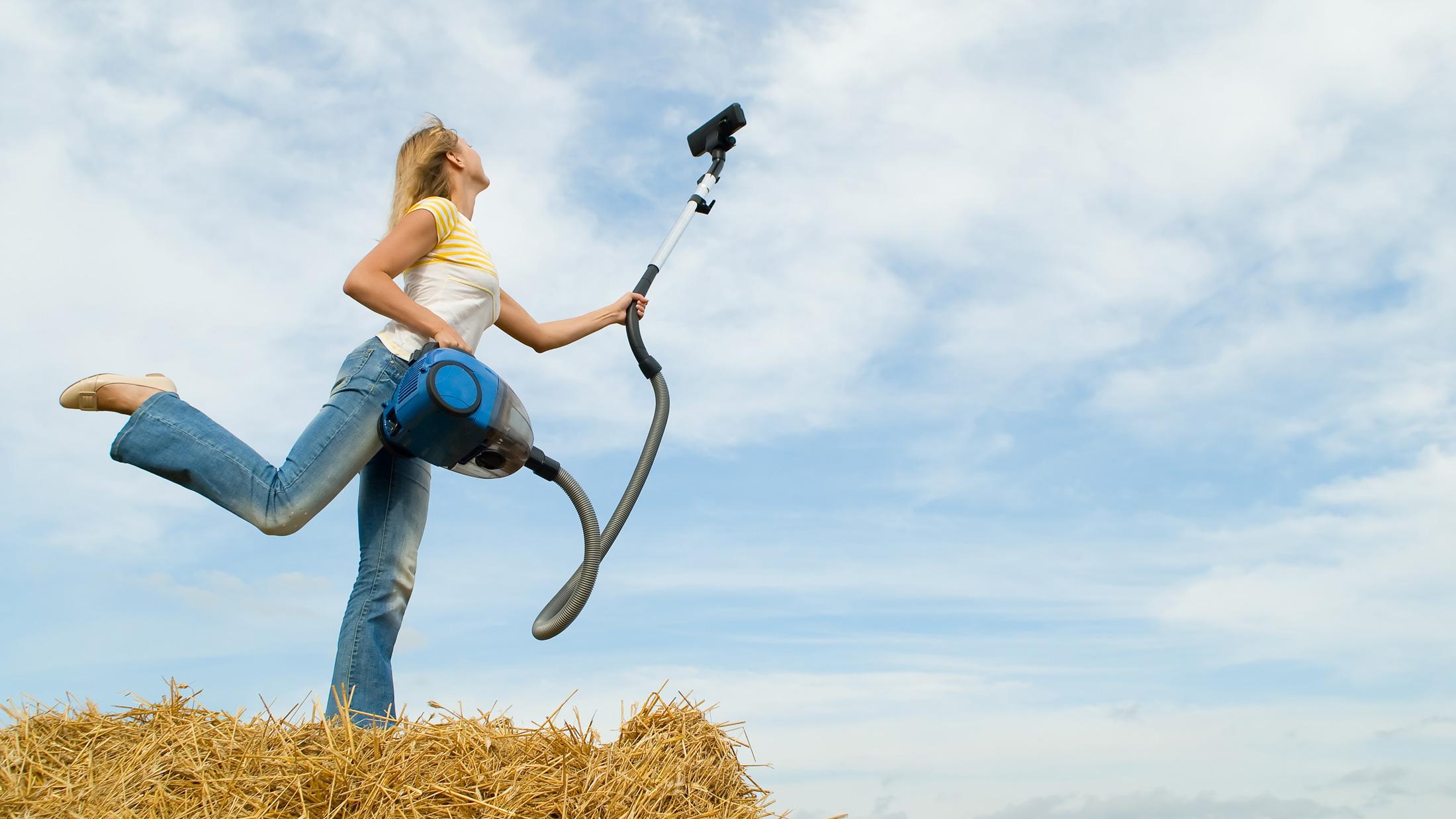 woman vacuuming sky
