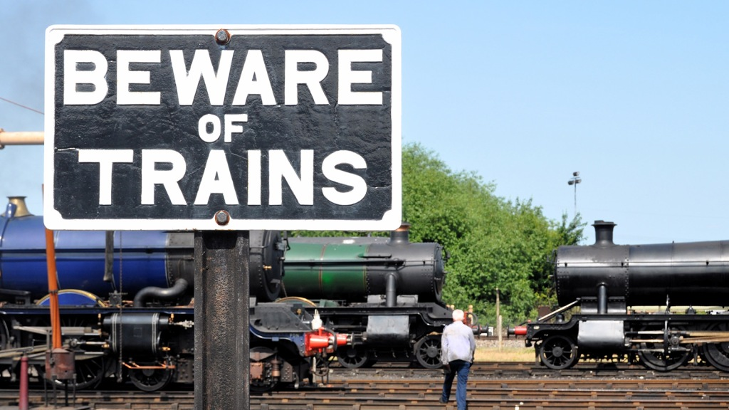 """""""beware of trains"""" sign"""