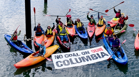 Kayaking activists paddle against coal on the part of the Columbia River where Ambre hopes to transfer coal from barges to ocean going vessels