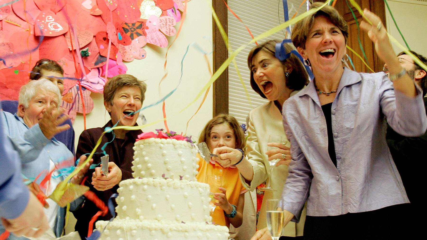 Original Plaintiff couples (R-L) Hillary and Julie Goodridge, their daughter Annie, 9, lawyer Mary Bonauto and an unidentified couple react as streamers are set off during a First Year Anniversary Celebration of the legalization of Gay Marriage at Unitarian Universalist Association Headquarters in Boston, Massachusetts, May 17, 2005.