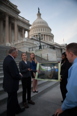 Project Localize students Ania Chamberlin, Cassie Kramer and Tessa Musa, with their teacher Mike Todd, share with Iowa Rep. Steve King (left) the story of a veteran, Jeff Hafner, who transformed his family's CAFO farm into a sustainable aquaponics farm in Iowa.