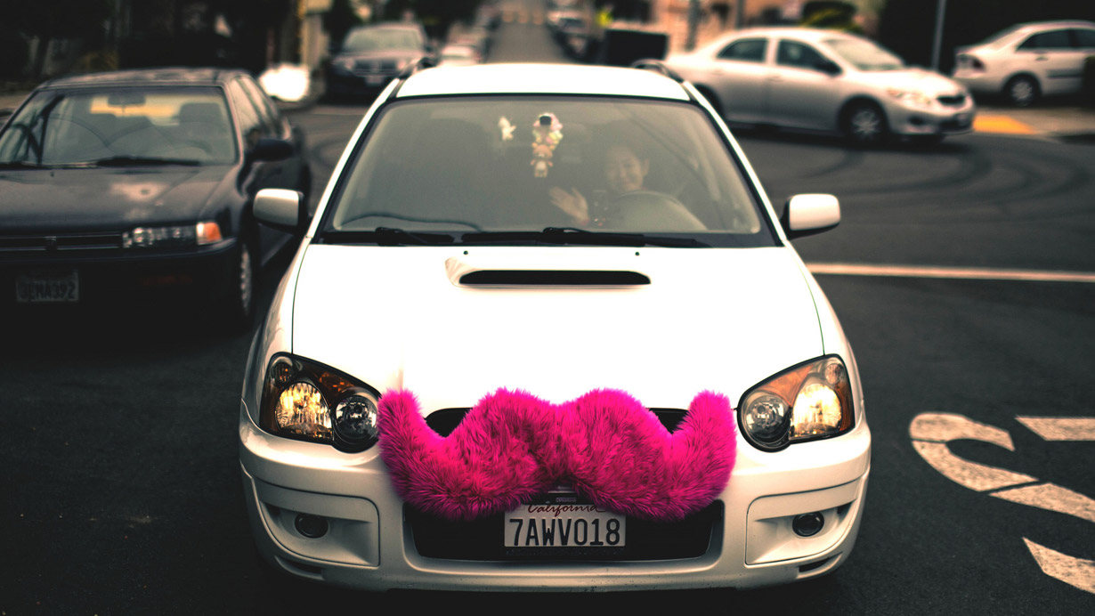 car with pink mustache