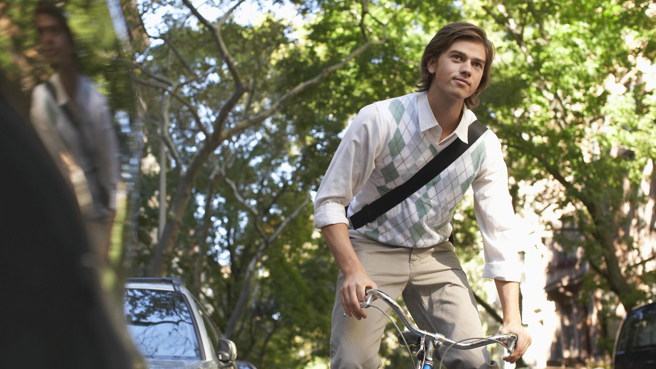 preppy guy on bike