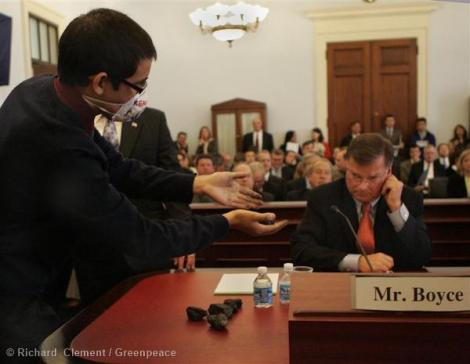 Young people confront Peabody CEO Greg Boyce at a congressional hearing in 2010