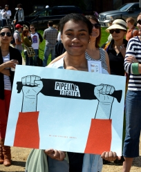 """girl with """"pipeline fighter"""" sign"""