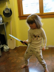 A, let's face it, totally gratuitous, but pretty funny picture of a kid with a knife. I dub her Knifegirl.