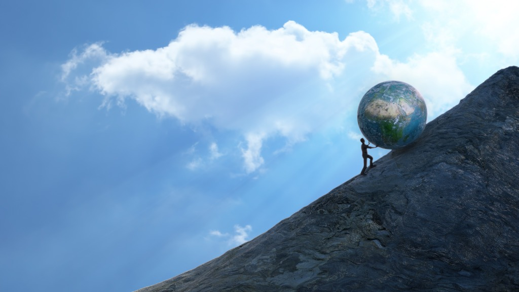man pushing Earth up a hill