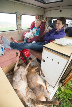 Ian Cummings may be excited about cooking up some roadside deer, but his wife seems less enthused.