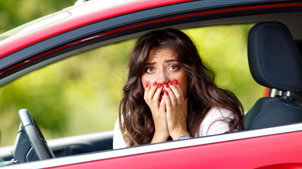 alarmed woman in car