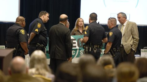 Police arrest Alexis Baden-Mayer of the Organic Consumers Association.