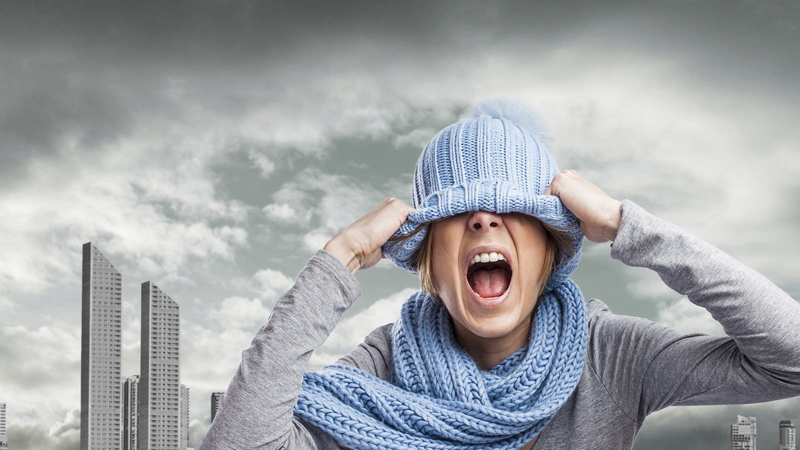 screaming young woman in front of polluted city