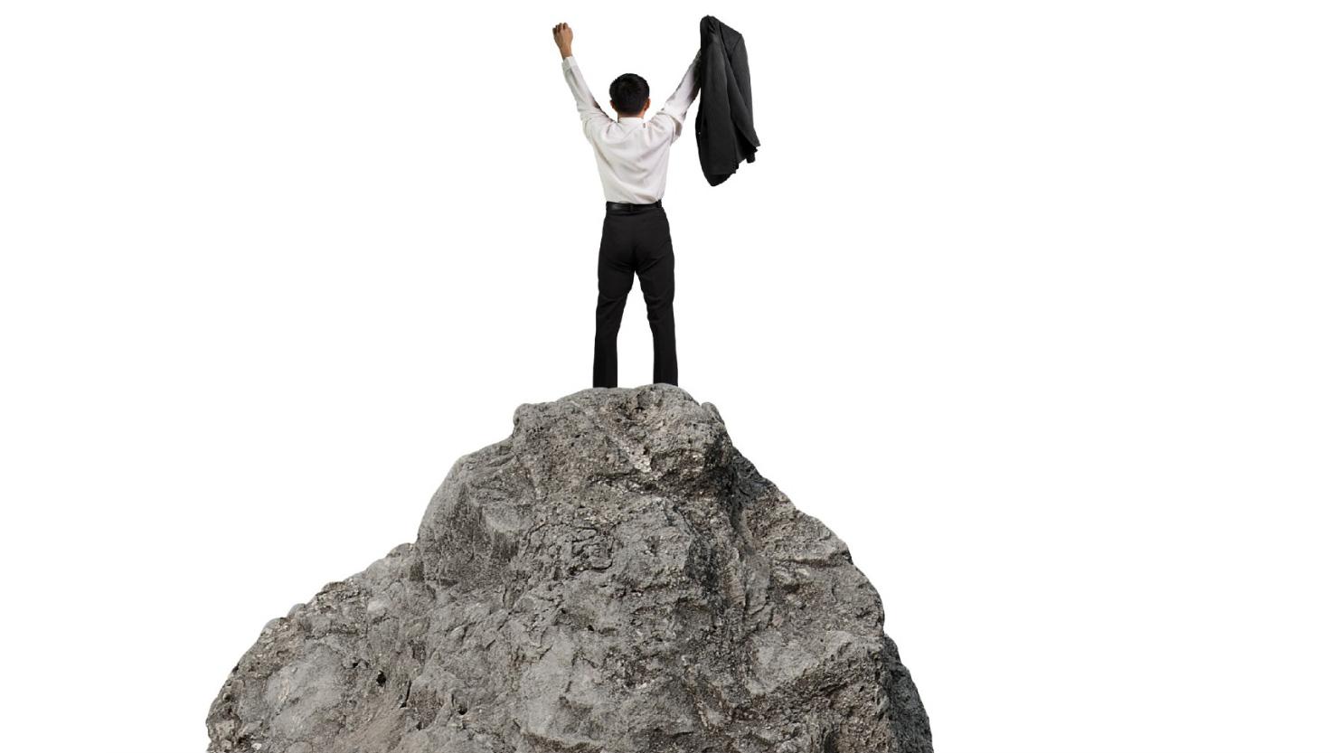 cheering man on mountaintop