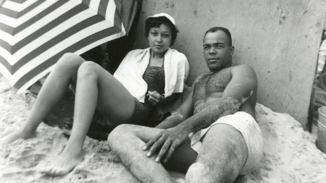 An unidentified couple lounging on Bay Shore Beach, outside Hampton, Virginia.