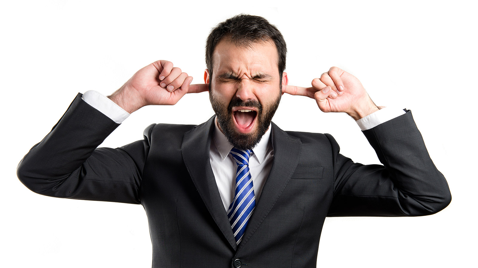 man with closed eyes and fingers in ears
