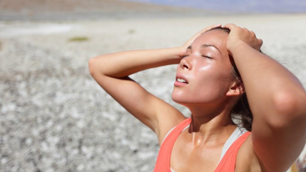 woman in desert, feeling the heat