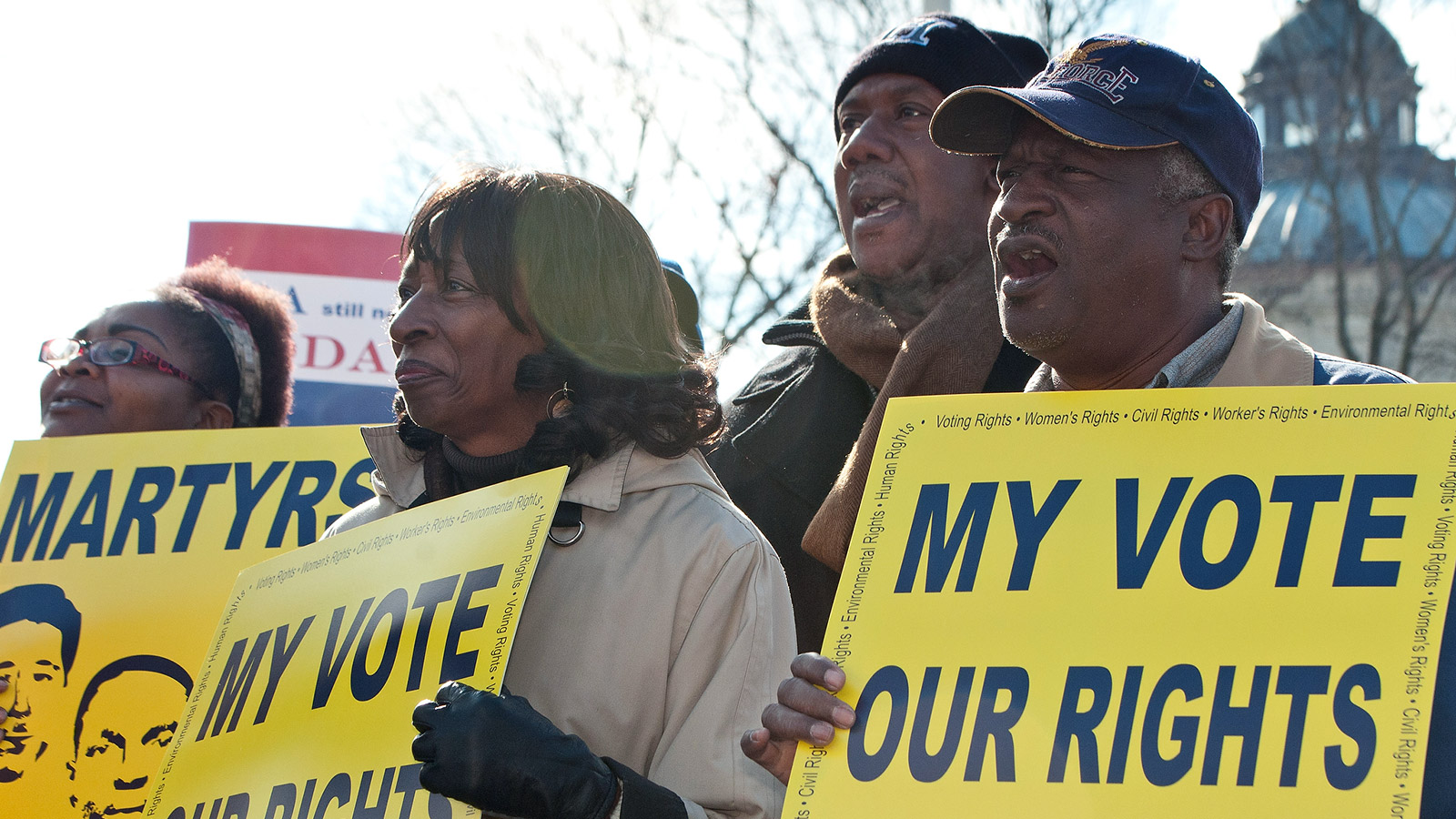 voting rights activists with signs