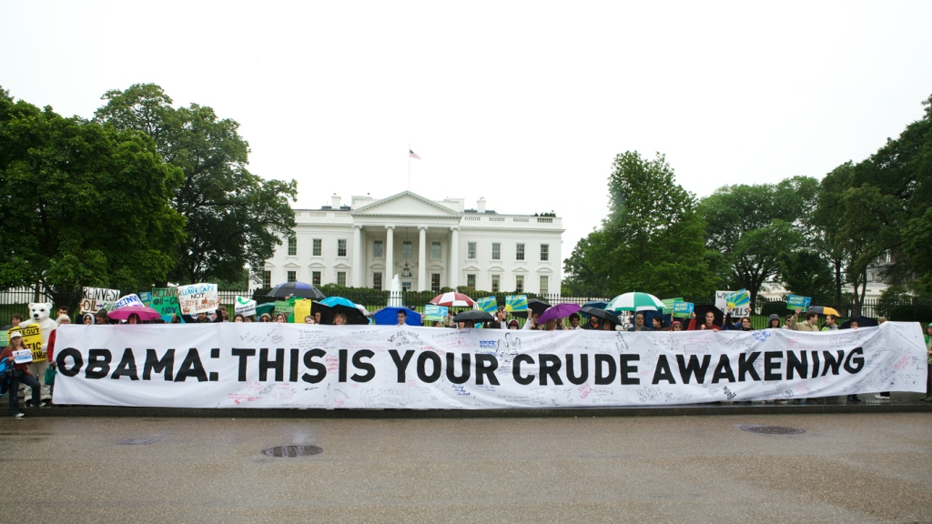 """protest sign: """"Obama: This is your crude awakening"""""""