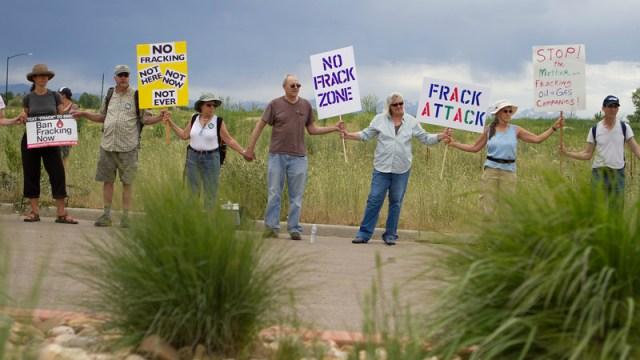 fracking protestors holding hands
