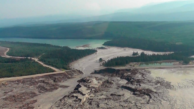 The results of a tailing pond breach at Imperial Metals Corp's gold and copper mine at Mount Polley in central British Columbia are pictured August 4, 2014
