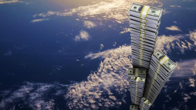 piles of money in sky