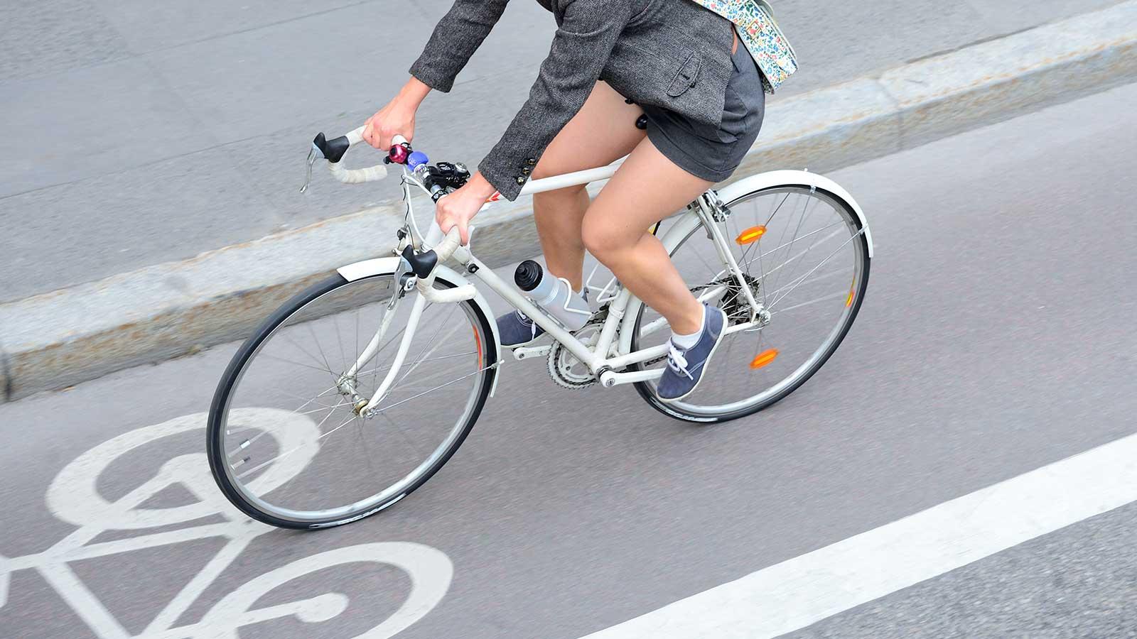 Woman riding bike in bike lane