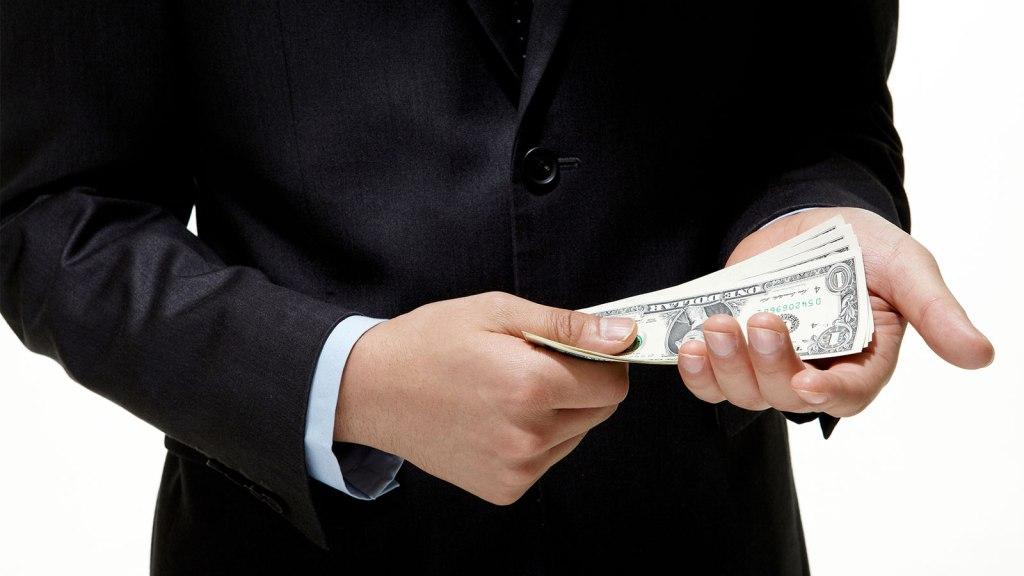 Businessman with bribe money