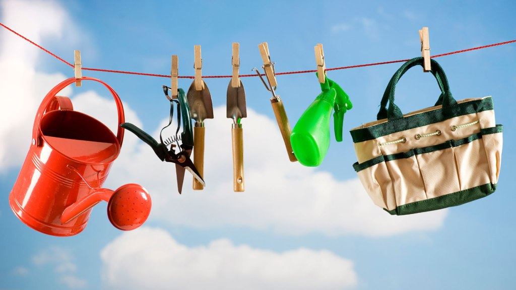 Gardening tools hung up on clothesline