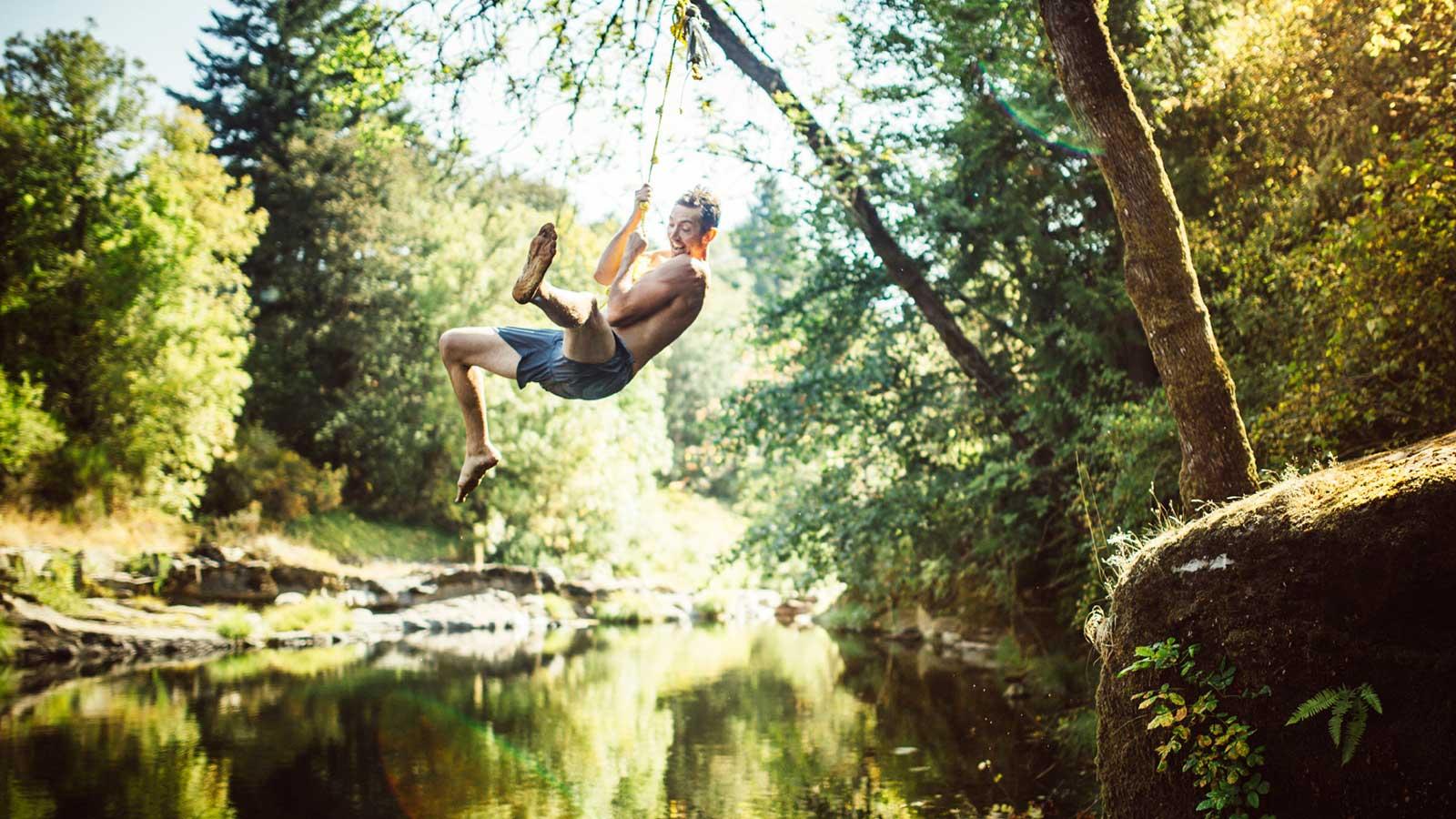 Man jumping into river