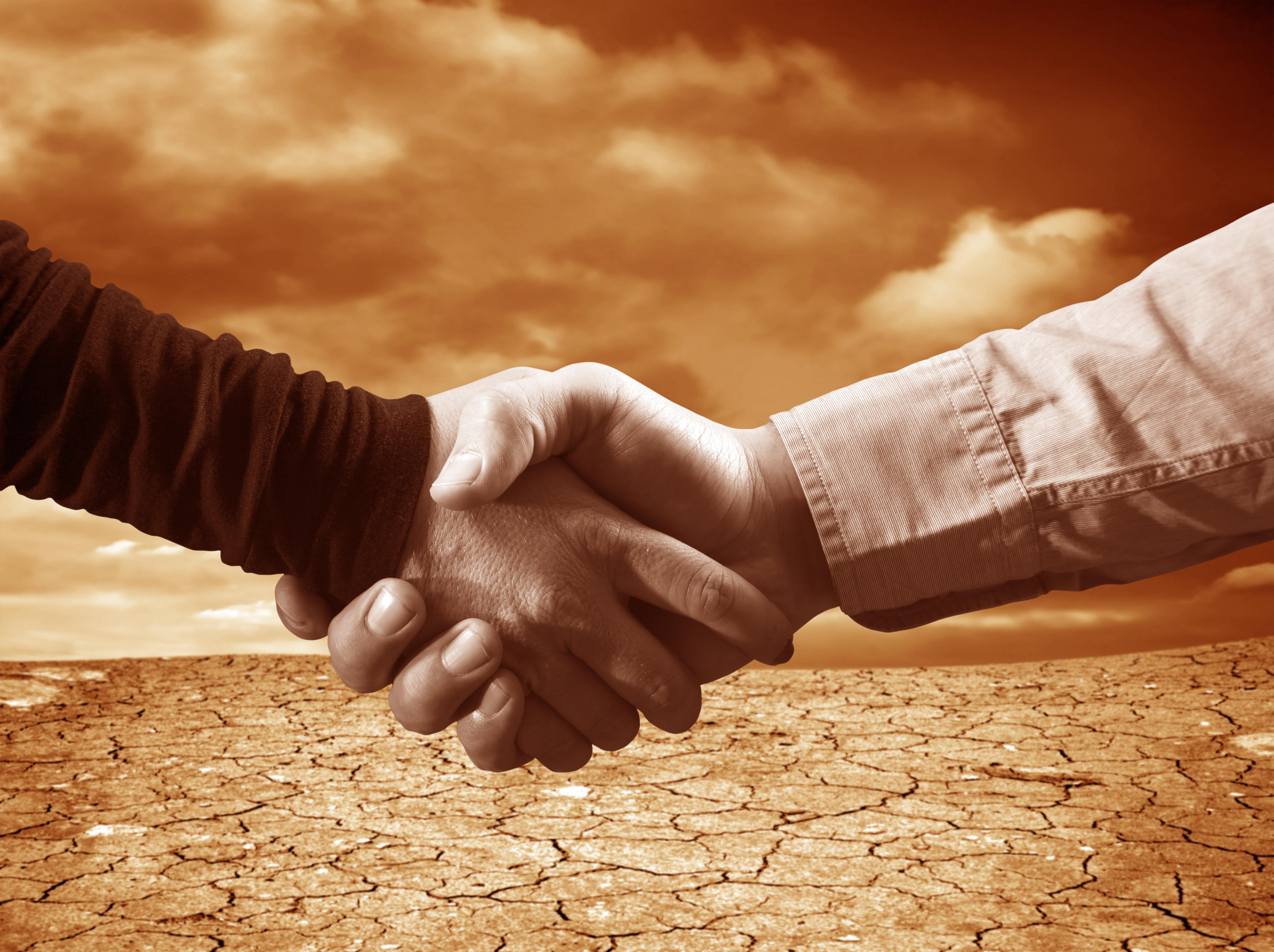 Handshake agreement negotiations desert sepia