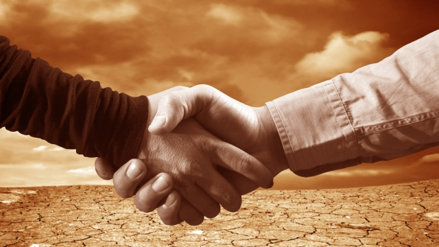 Handshake agreement negotiations desert sepia