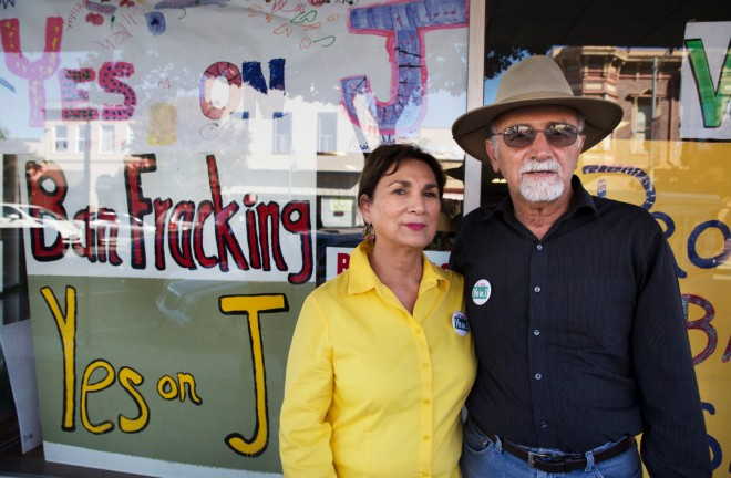 Margaret Morales Rebecchi stands with her husband Larry Rebecchi outside the Protect San Benito office in Hollister, Calif.