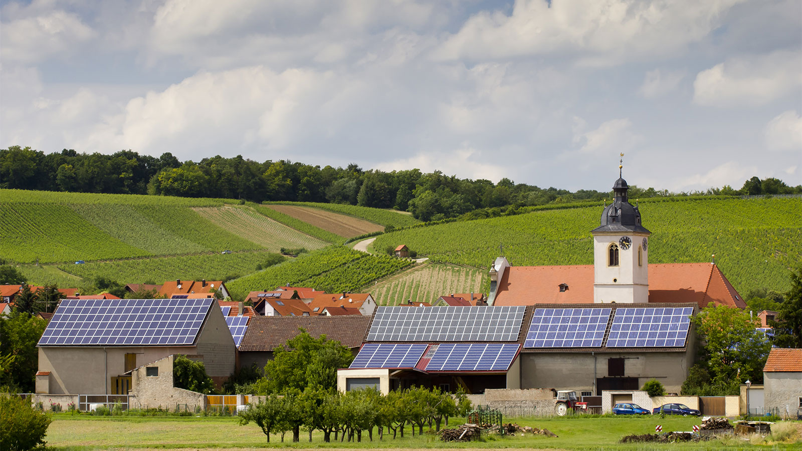 Solar panels installed on roofs in quaint village