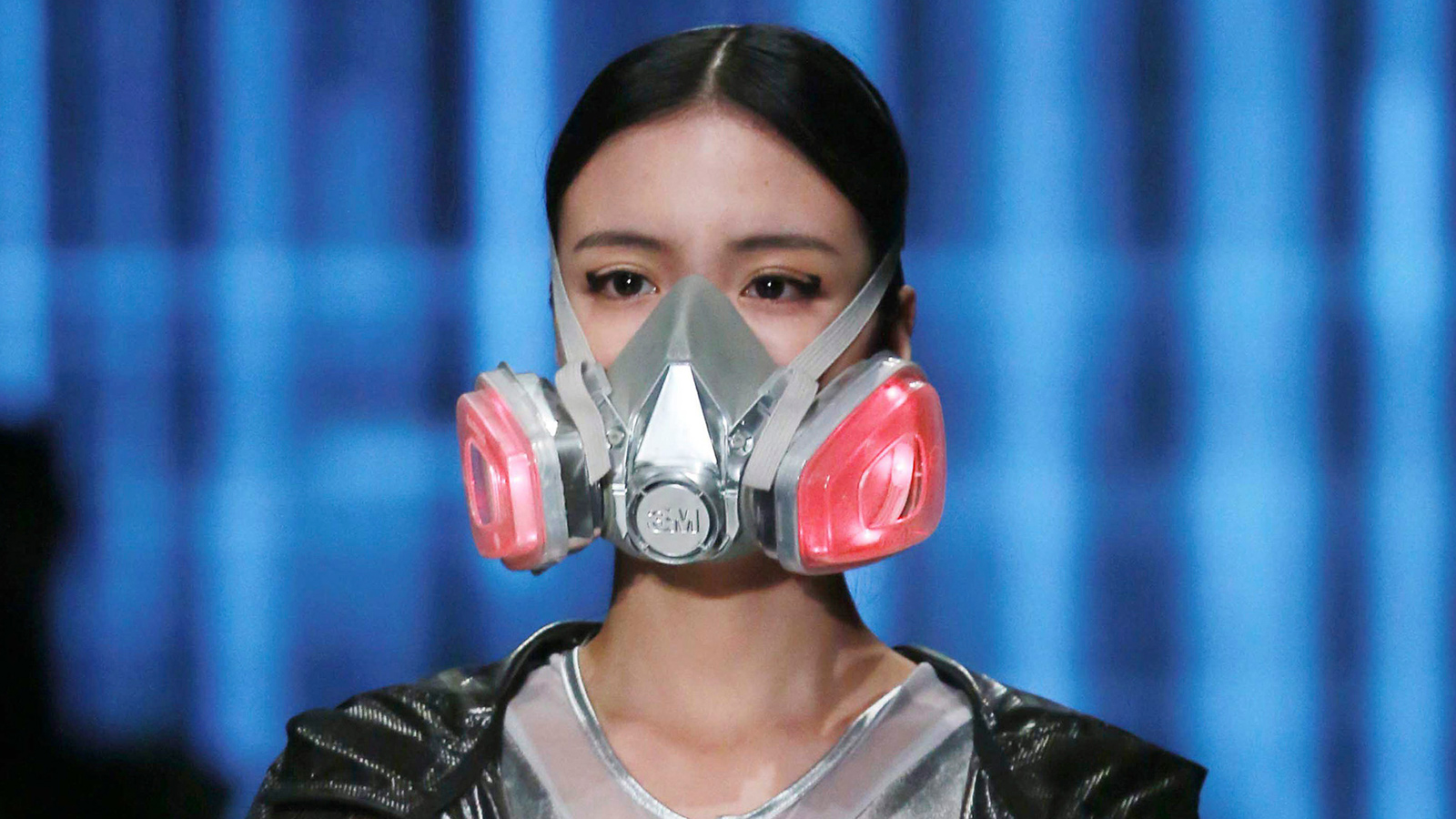 A model wearing a mask presents a creation at the QIAODAN Yin Peng Sports Wear Collection show during China Fashion Week in Beijing, October 28, 2014.