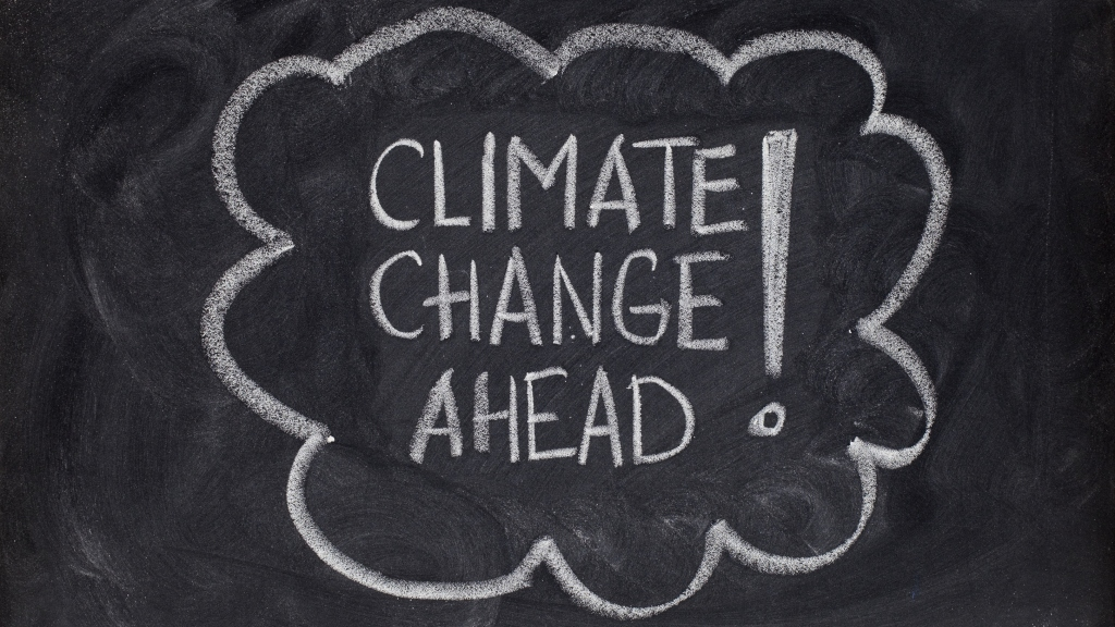 "chalkboard writing: ""Climate change ahead!"""