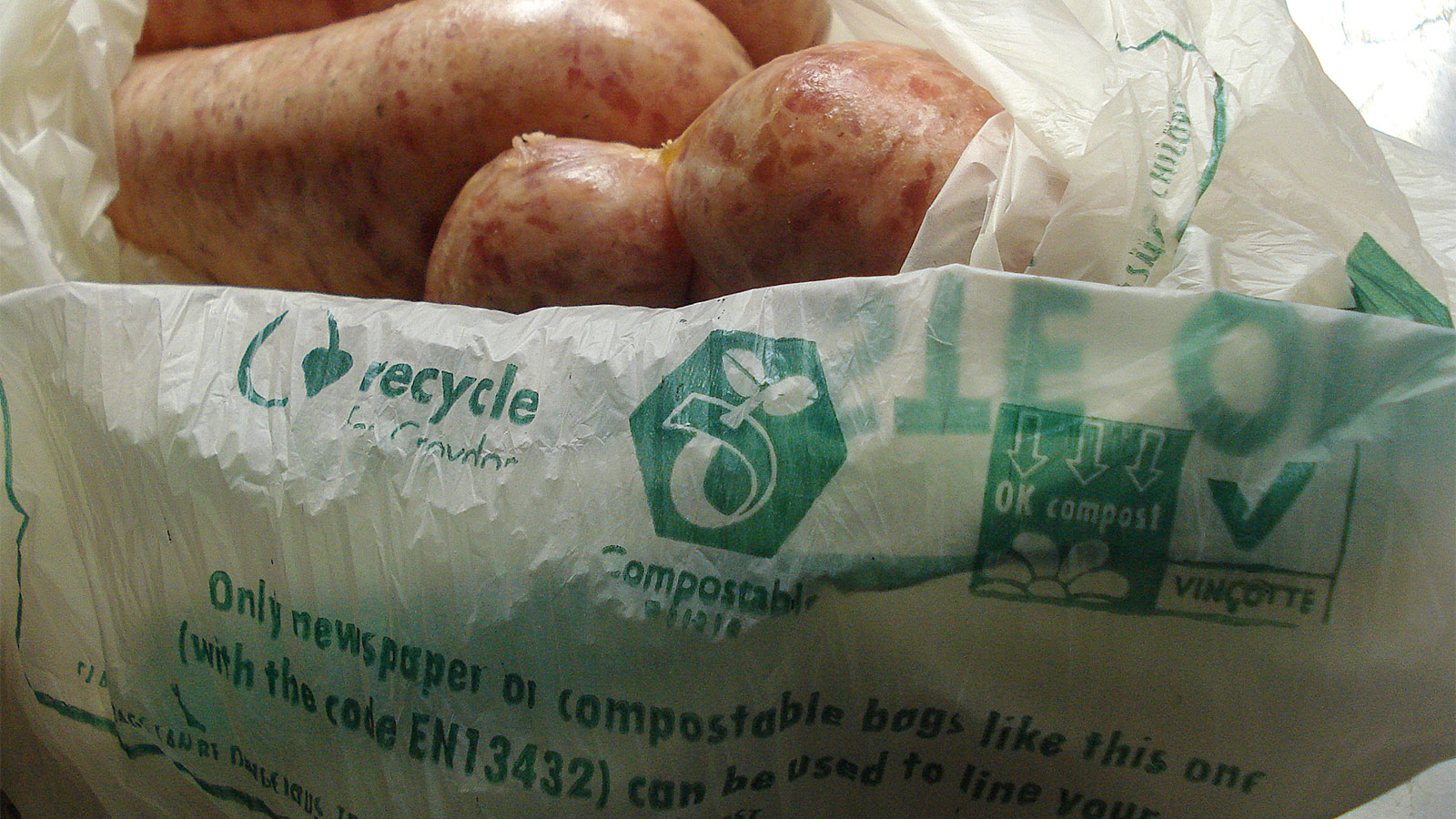 Compostable plastic bag filled with delicious sausages.