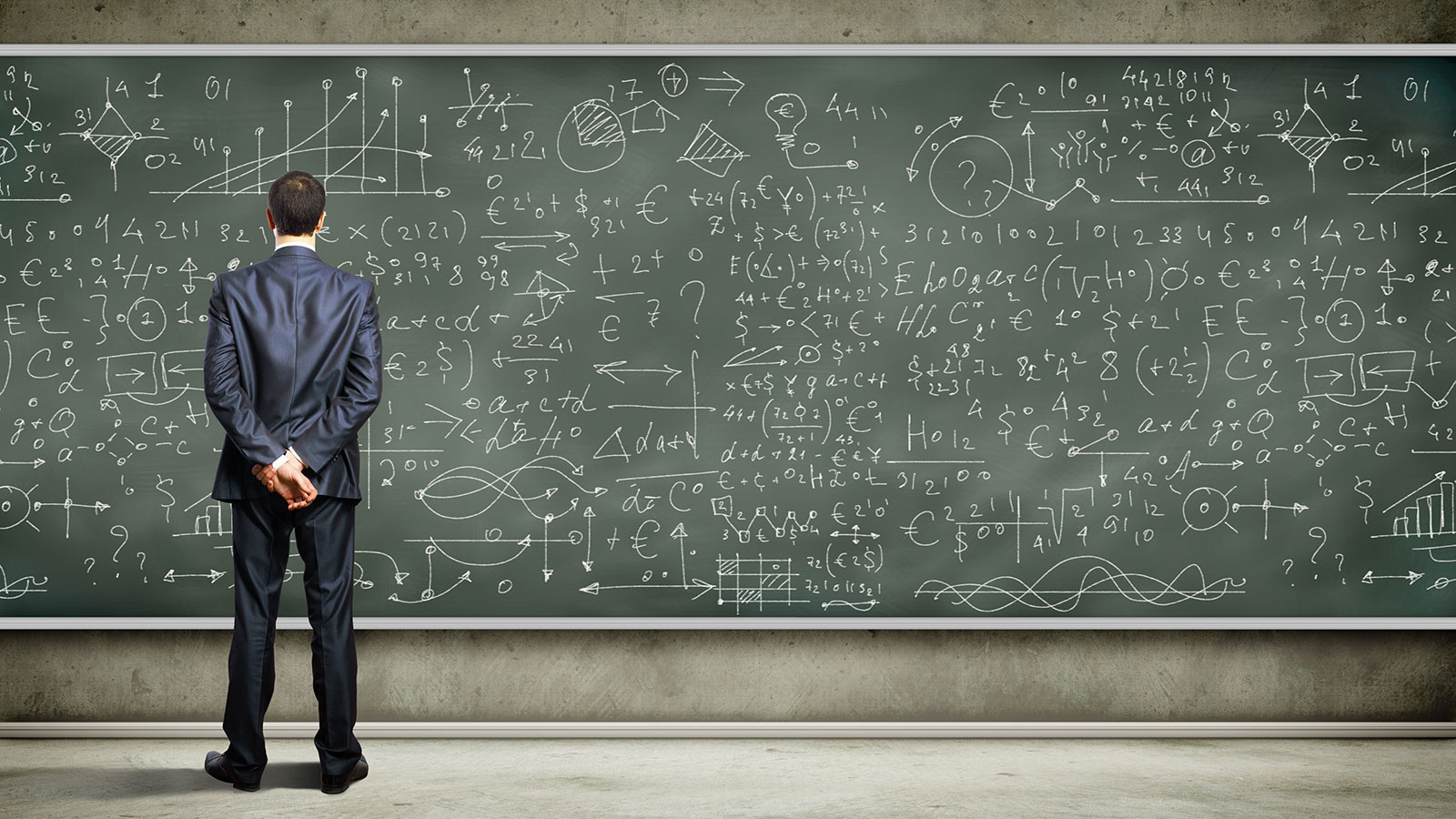 min in front of blackboard