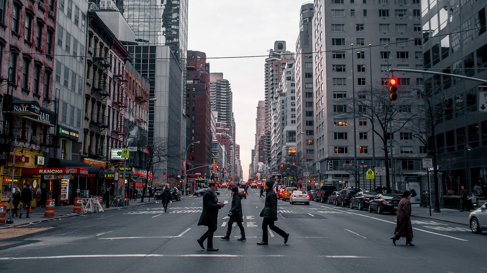 Pedestrians crossing street in New York City