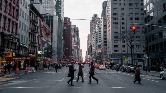 Pedestrians crossing street in New York City