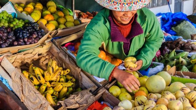 Peruvian woman selling fruit