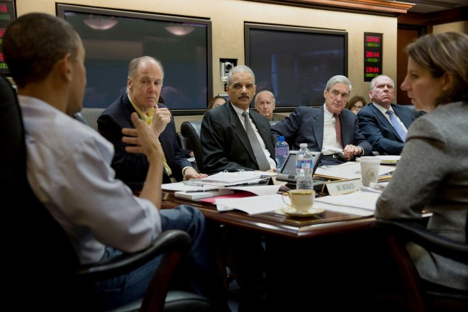 Holder attending a presidential meeting